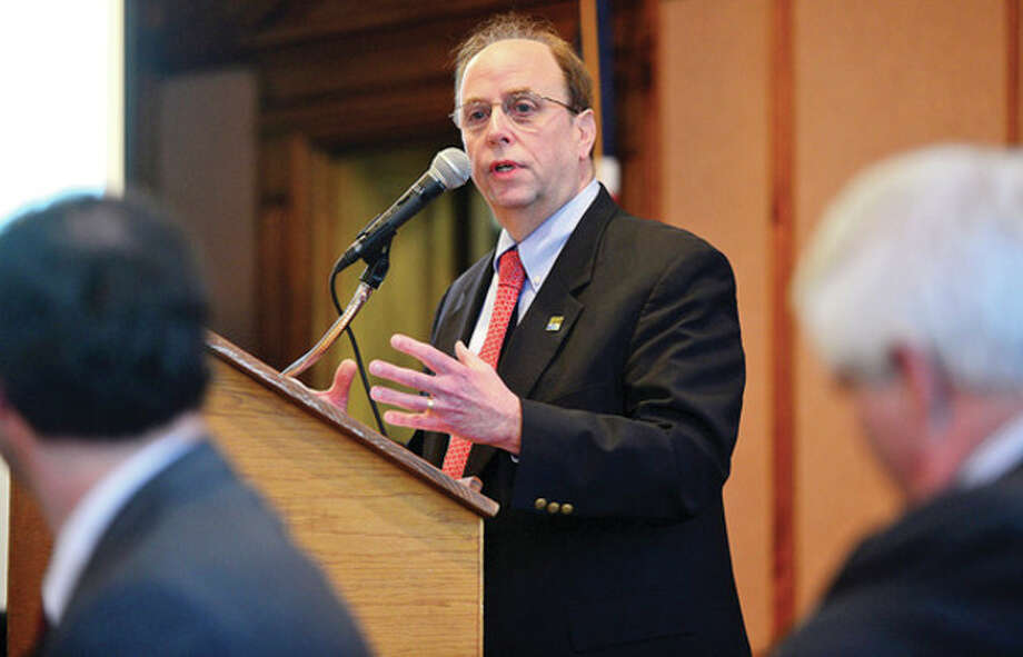 David Kennedy gives an overview of Greater Norwalk Opening Doors to the Greater Norwalk Regional Alliance to Prevent and End Homelessness Leadership Council and Steering Committee as they meet in Community Room of City Hall on Friday morning.Hour photo / Erik Trautmann / (C)2013, The Hour Newspapers, all rights reserved