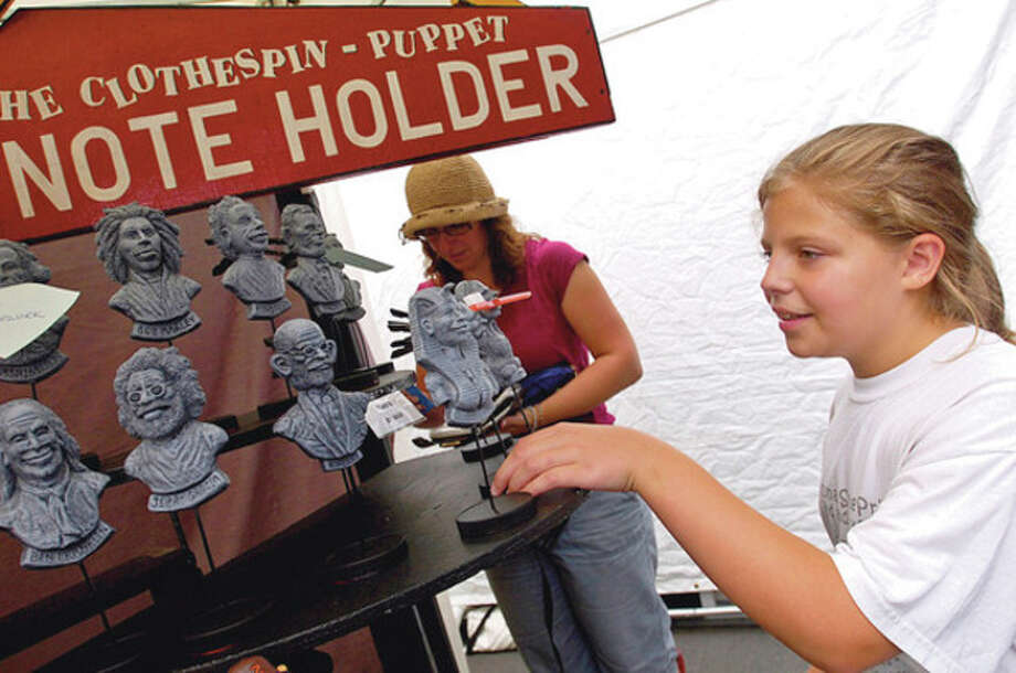 Carlin Barton picks out a Clothespin-Puppet Note Holder with her mom Helen Barton Saturday at the 2011 SONo Arts Festival.Hour photo / Erik Trautmann / (C)2011, The Hour Newspapers, all rights reserved