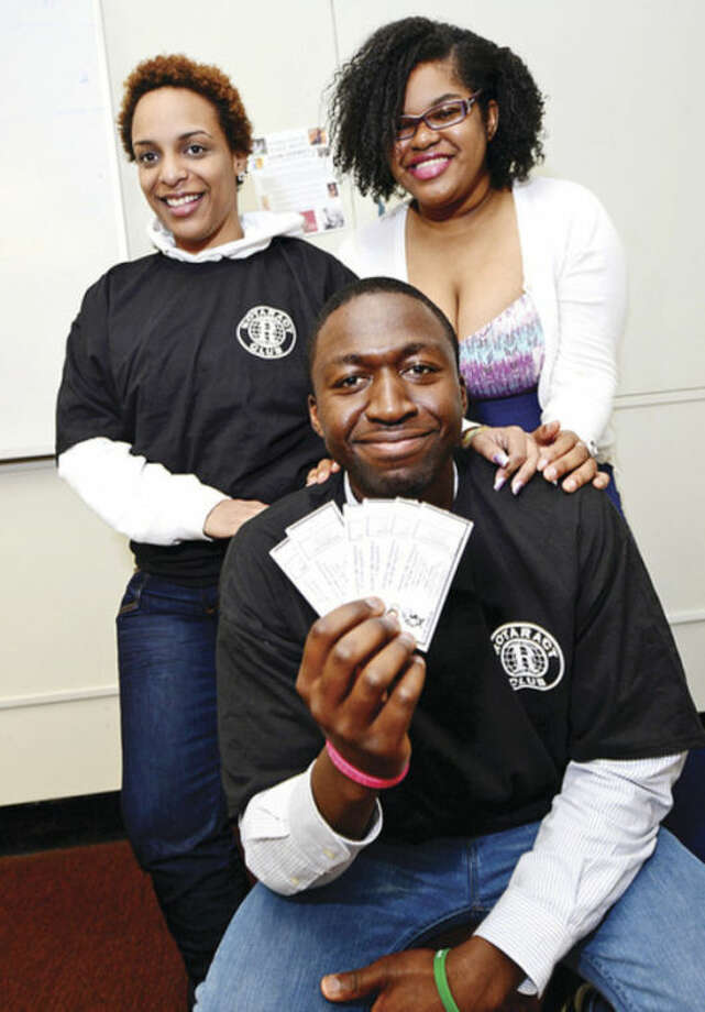 @Cutline Byline:Hour photo /Erik TrautmannNCC students James Charlot, Sagina Maigan and Christine Fils-Aime are helping organize a Rotoact Club talent show and scholarship fundraiser in honor Wycliff Bel Jean, who was murdered last year in Stamford.