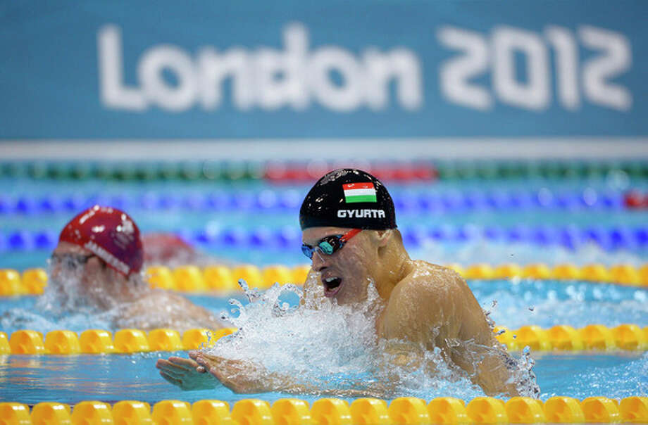 Hungary's Daniel Gyurta competes to win gold in the men's 200-meter breaststroke swimming final at the Aquatics Centre in the Olympic Park during the 2012 Summer Olympics in London, Wednesday, Aug. 1, 2012. (AP Photo/Mark J. Terrill) / AP