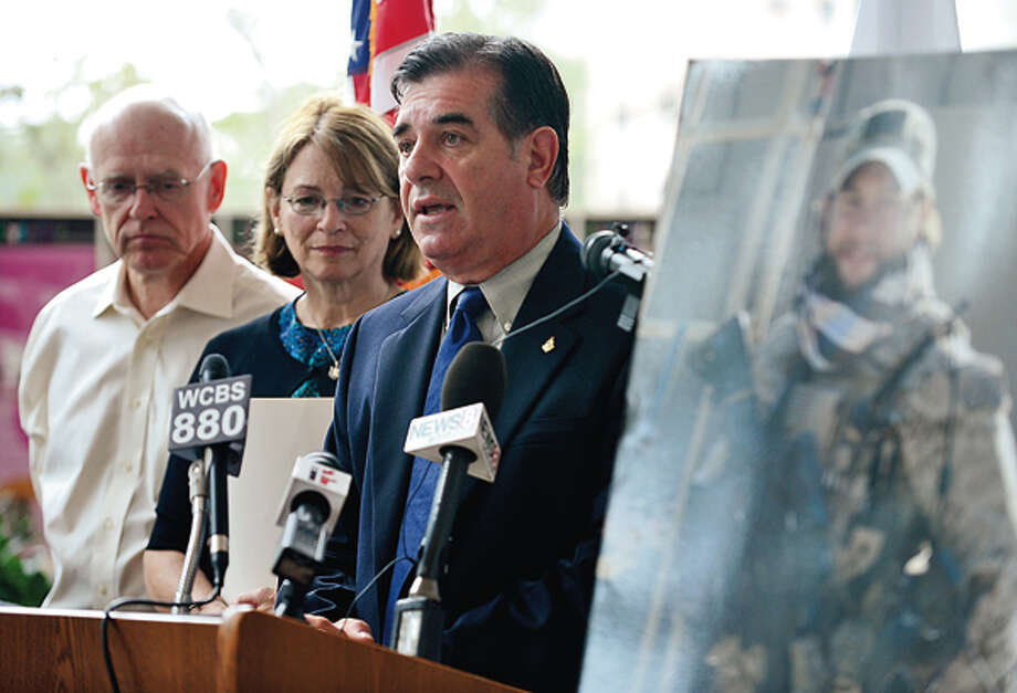Mayor Michael Pavia speaks during a press conference to remember the one year death of Chief Petty Officer Brian Bill who was killed Afghanistan while Bill's parents, Mike and Pat Perry look on Wednesday. Hour photo / Erik Trautmann / (C)2012, The Hour Newspapers, all rights reserved