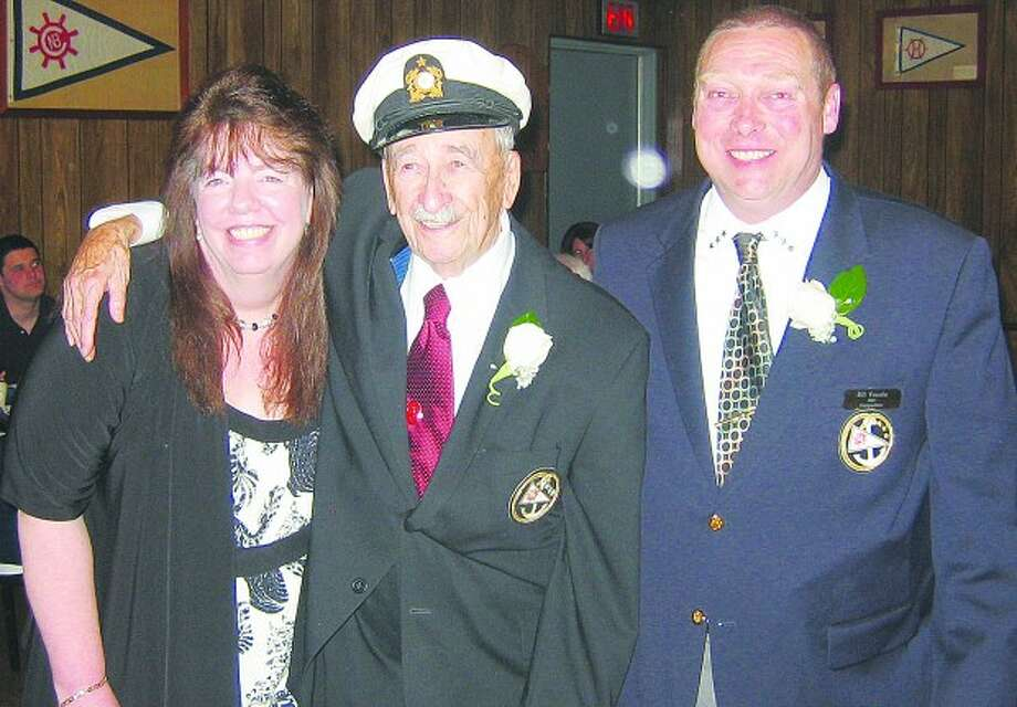 Contributed photo... Ralph E. Boyle, center, is surrounded by Norwalk Boat Club Commodore Cheryl Roosa and Vice Commodore Bill Vasale. at Saturday
