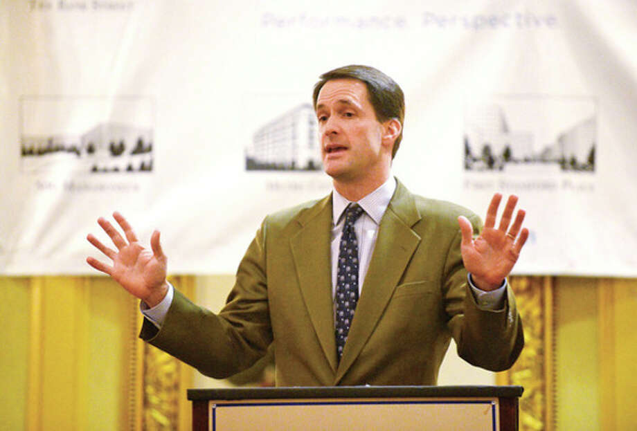 Hour photo / Erik TrautmannCongressman Jim Himes, D-4, speaks to members of the Stamford Chamber of Commerce at the Stamford Plaza Thursday. / (C)2013, The Hour Newspapers, all rights reserved