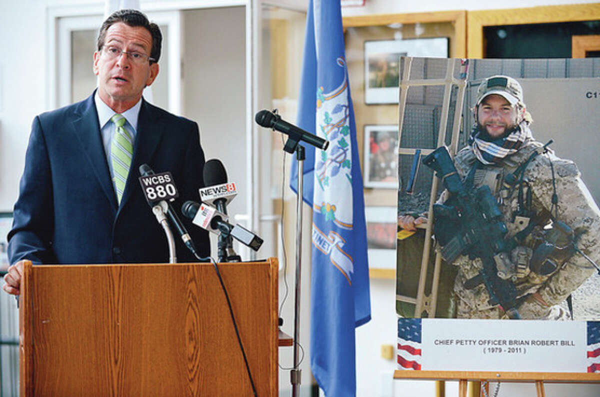 Gov. Dannel P. Malloy speaks about Chief Petty Officer Brian Bill during the press conference in the Government Center lobby Wednesday in Stamford.