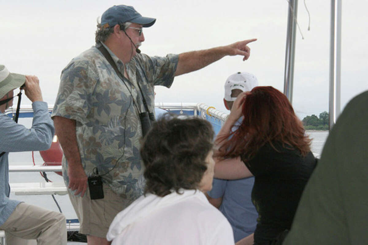 Master Wildlife Conservationist Larry Flynn points out a bird on the Norwalk Seaport Association bird cruise held Sunday.