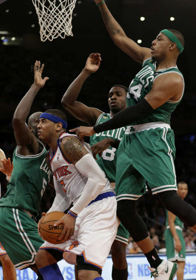 New York Knicks forward Carmelo Anthony (7) is surrounded by Boston Celtics center Kevin Garnett (5), forward Jeff Green (8) and forward Paul Pierce (34) in the first half of Game 5 of their first-round NBA basketball playoff series at Madison Square Garden in New York, Wednesday, May 1, 2013. (AP Photo/Kathy Willens)