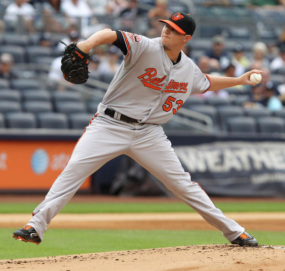 Baltimore Orioles' Zach Britton pitches during the first inning of the baseball game against the New York Yankees, Wednesday, Aug. 1, 2012, at Yankee Stadium in New York. (AP Photo/Seth Wenig) / AP