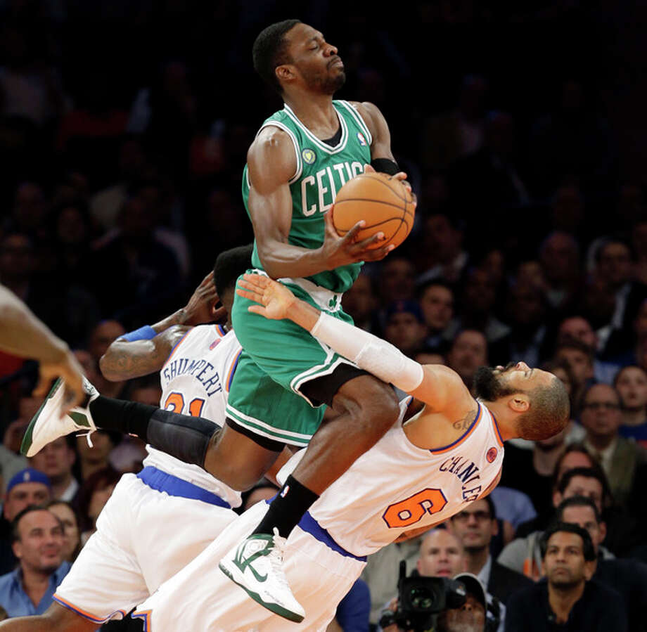 Boston Celtics forward Jeff Green (8) collides with New York Knicks center Tyson Chandler (6) in the first half of Game 5 of their first-round NBA basketball playoff series at Madison Square Garden in New York, Wednesday, May 1, 2013. (AP Photo/Kathy Willens) / AP