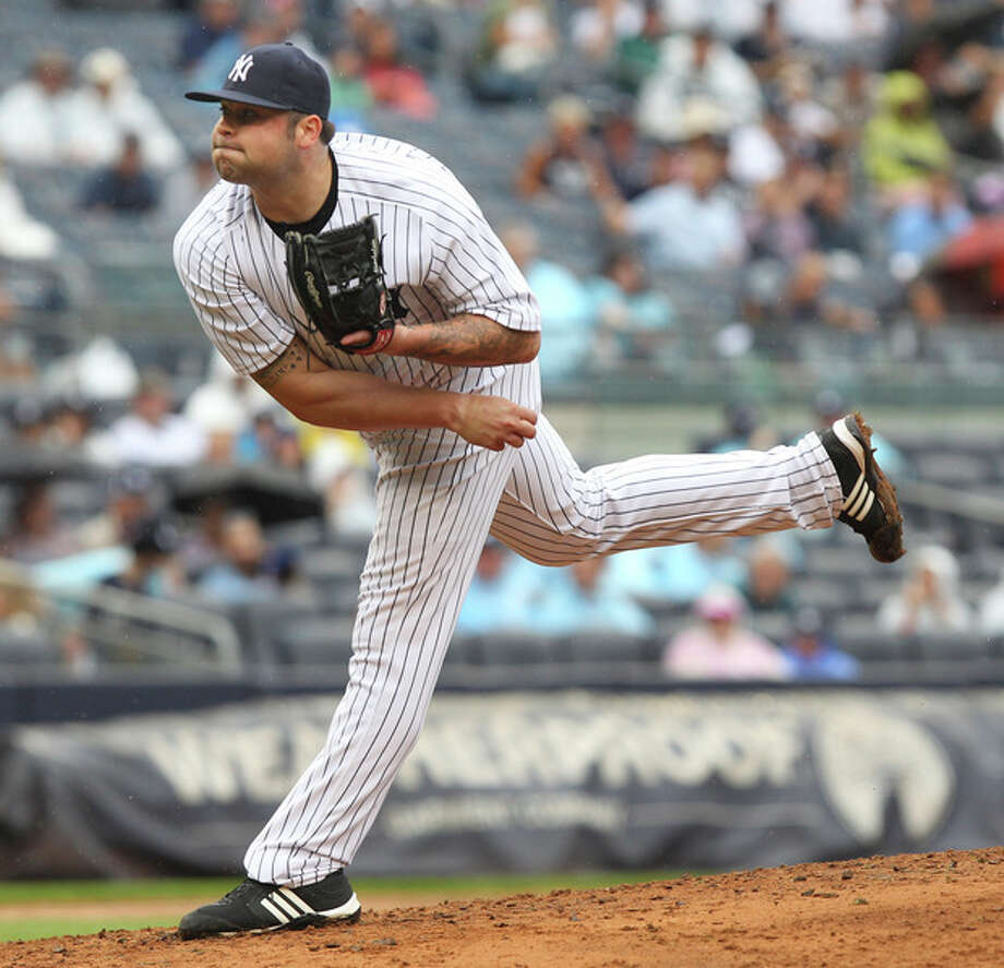 New York Yankees' Joba Chamberlain pitches during the seventh inning of the baseball game against the Baltimore Orioles, Wednesday, Aug. 1, 2012, at Yankee Stadium in New York. (AP Photo/Seth Wenig) / AP