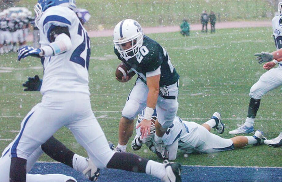 Robie Wolf of Staplesruns for a TD in their game against Darien Saturday in Westport. Hour photo / Erik Trautmann / (C)2011, The Hour Newspapers, all rights reserved
