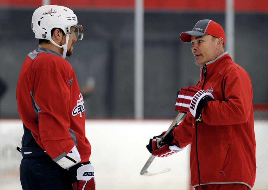 Washington Capitals' Alex Ovechkin, left, of Russia, talks with coach Adam Oates, right, during NHL hockey team practice at the Kettler Capitals Iceplex in Arlington, Va. Wednesday, May 1, 2013. The Capitals host the New York Rangers in Game 1 of a first-round NHL hockey Stanley Cup playoff series on Thursday. (AP Photo/Susan Walsh) / AP