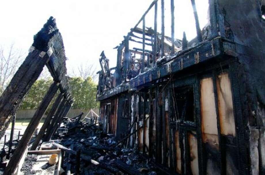 Photo/Alex von Kleydorff. The rear side of a home on Powder Horn Dr. that burned on Sunday night.
