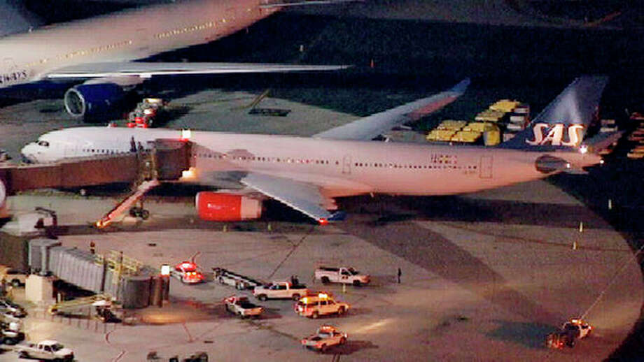In this image taken from video and provided by television station WNBC-TV, a damaged SAS Airbus A330 sits on the tarmac at New Liberty International Airport after clipping the wing of another aircraft on takeoff, Wednesday, May 1, 2013 in Newark, N.J. Federal Aviation Administration officials say no one was injured in the incident at about 7:30 p.m. (AP Photo/WNBC-TV) MANDATORY CREDIT / WNBC-TV