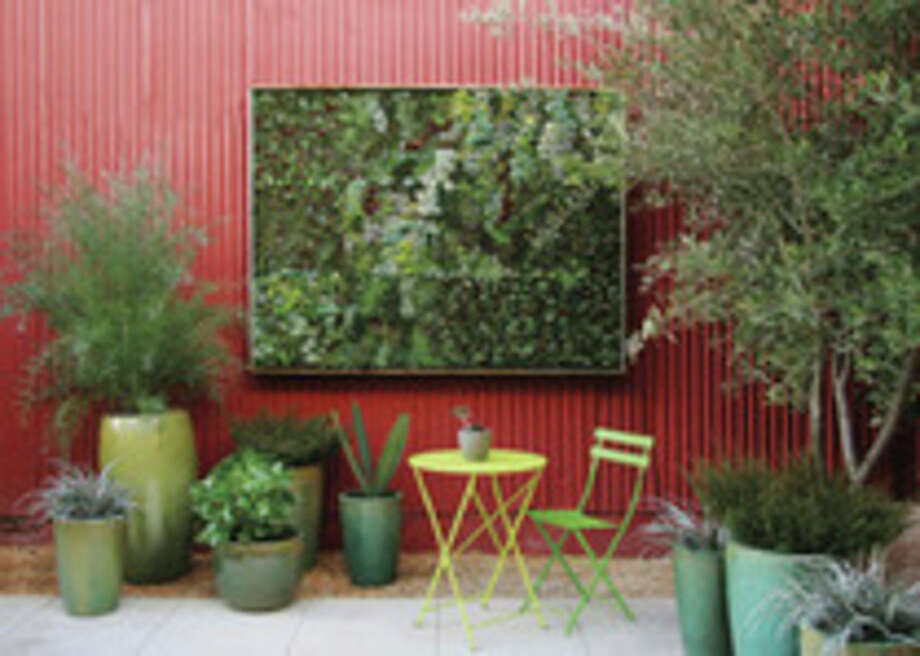 AP photoThis undated publicity photo courtesy of Flora Grubb Gardens shows a large living succulent wall in an outdoor area at Flora Grubb Gardens in San Francisco. Living pictures, cuttings of assorted succulents woven together in everything from picture frames to pallet boxes, are hot among garden designers and landscapers this spring as an easy, modern way to add color and texture to an outdoor space. / Flora Grubb Gardens