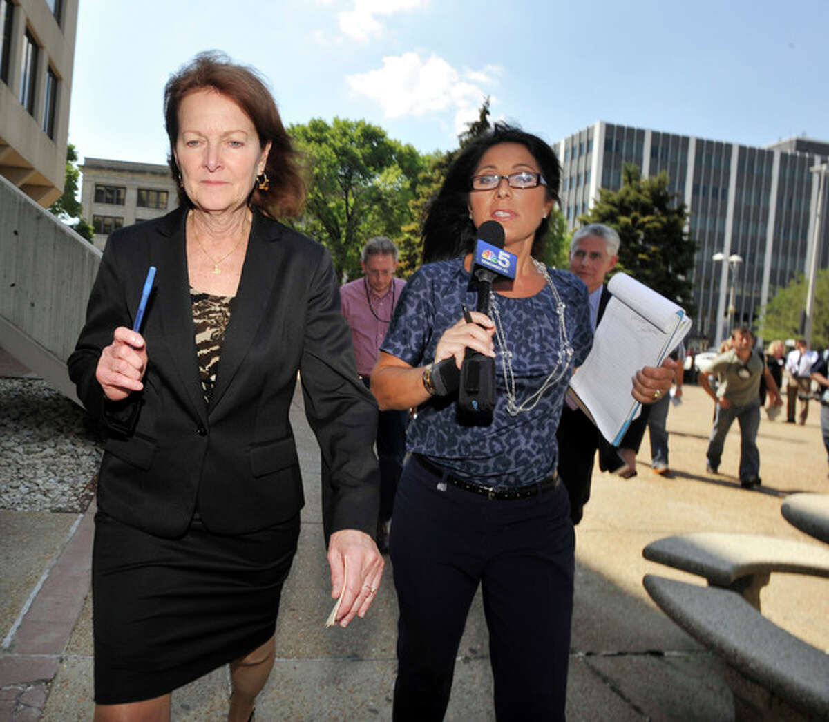 Will County States Attorney Kathleen Patton left, leaves the Will County Courthouse after the second day of the murder trial of Drew Peterson, Wednesday, Aug. 1, 2012 in Joliet, Ill.. Peterson, 58, is charged with killing his third wife, Kathleen Savio, in 2004. Her body was found in a dry bathtub in her home, her hair soaked with blood. He is also a suspect in the 2007 disappearance of his fourth wife, Stacy Peterson. (AP Photo/Paul Beaty)