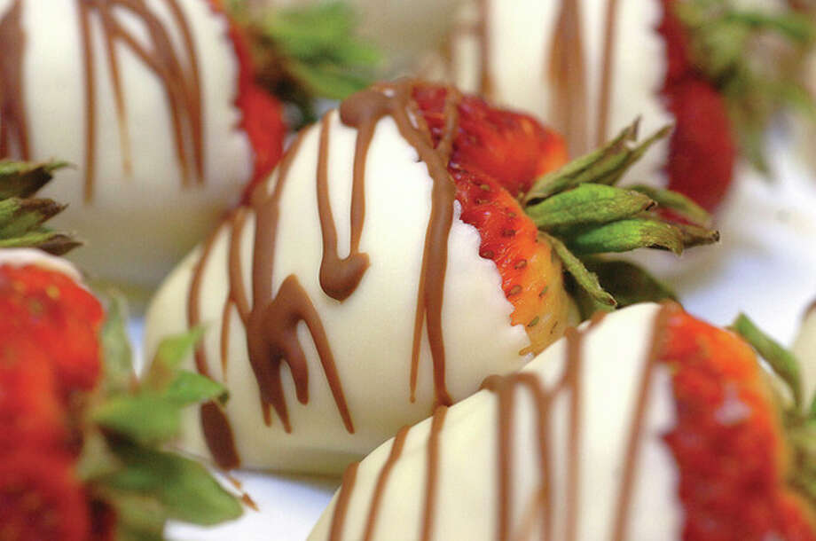 Hour Photo/ Alex von Kleydorff. White Chocolate covered strawberries at Chocolate rain. / 2012 The Hour Newspapers