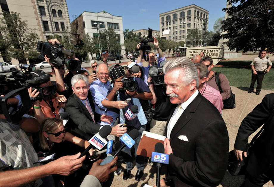 Will County State's Attorney James Glasgow speaks to the media outside the Will County Courthouse after the second day of the murder trial of Drew Peterson, Wednesday, Aug. 1, 2012 in Joliet, Ill.. Peterson, 58, is charged with killing his third wife, Kathleen Savio, in 2004. Her body was found in a dry bathtub in her home, her hair soaked with blood. He is also a suspect in the 2007 disappearance of his fourth wife, Stacy Peterson. (AP Photo/Paul Beaty) / FR36811 AP
