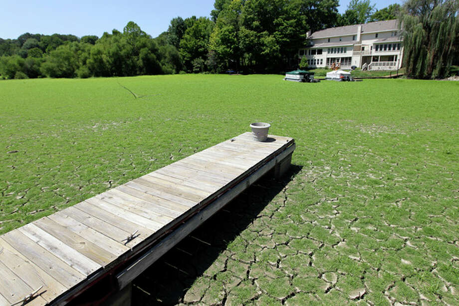 A dock extends into a dry cove where grass has begun to grow at Morse Reservoir in Noblesville, Ind., Wednesday, Aug. 1, 2012. The reservoir is six feet below normal levels. More than half of U.S. counties now are classified by the federal government as natural disaster areas mostly because of the drought. The U.S. Agriculture Department on Wednesday added 218 counties in a dozen states as disaster areas. That brings this year's total to 1,584 in 32 states, more than 90 percent of them because of the drought. (AP Photo/Michael Conroy) / AP