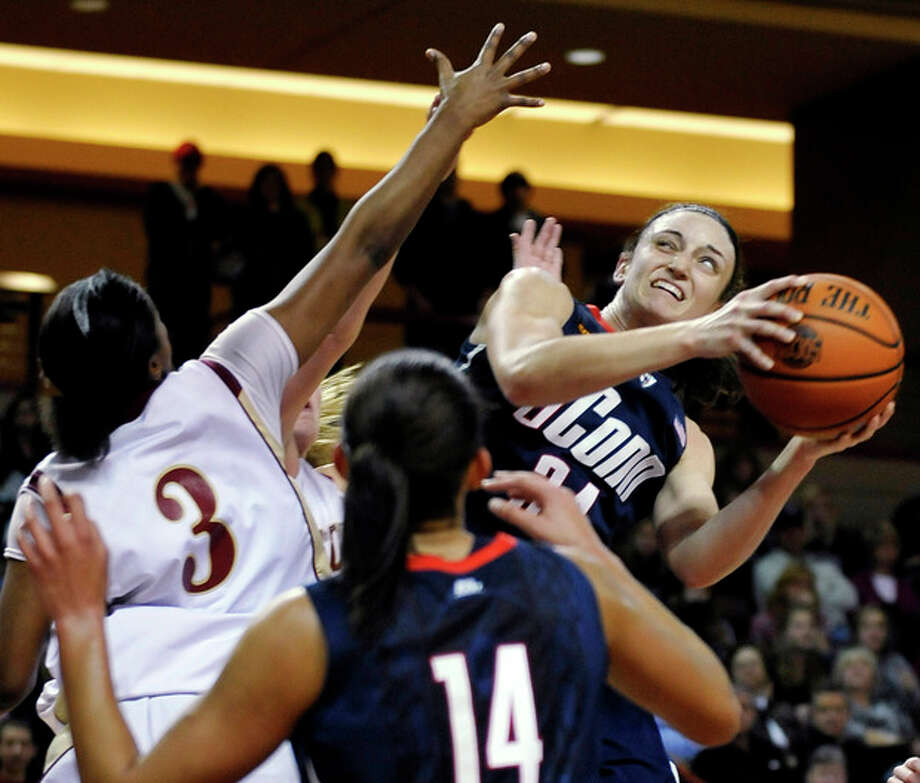 Connecticut's Kelly Faris (34) looks to shoot as College of Charleston's Jazz Green (3) defends during the first half of an NCAA college basketball game on Wednesday, Dec. 21, 2011, in Charleston, S.C. (AP Photo/Rainier Ehrhardt) / FR155191 AP