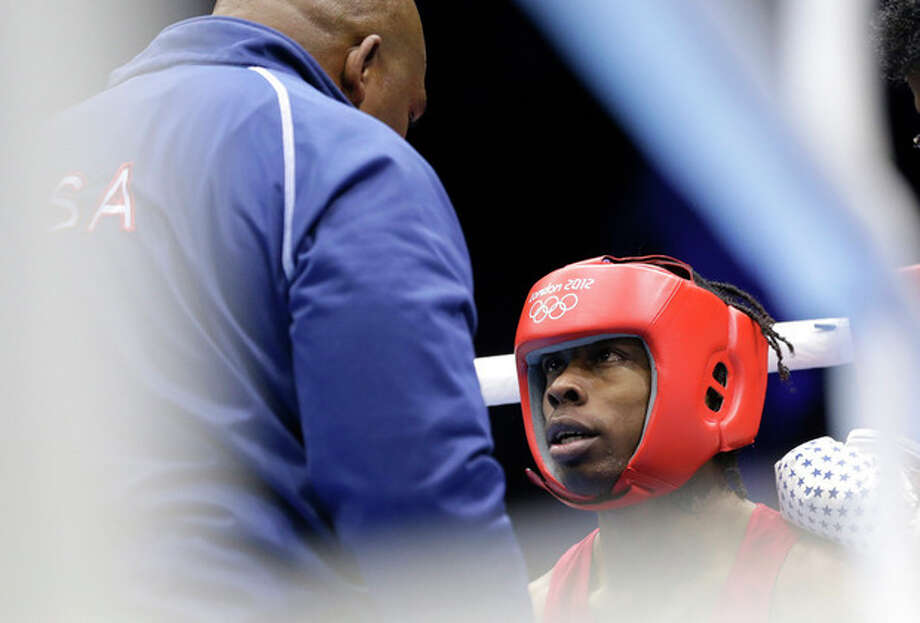 United States' Warren Raushee sits in his corner during a fight with France's Nordine Oubaali in a men's flyweight 52-kg preliminary boxing match at the 2012 Summer Olympics, Friday, Aug. 3, 2012, in London. (AP Photo/Patrick Semansky) / AP