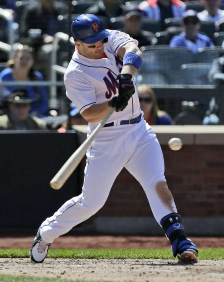 New York Mets' David Wright hits a sacrifice fly during the sixth inning of the baseball game against the Los Angeles Dodgers at Citi Field Thursday, April 25, 2013, in New York. (AP Photo/Seth Wenig)