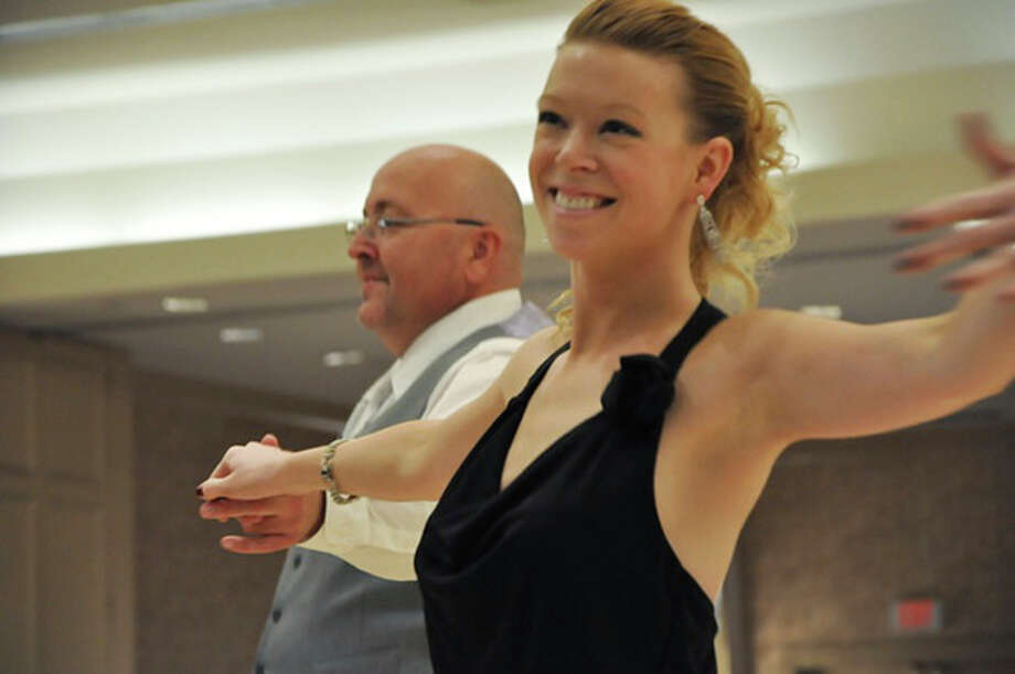 This 2012 photo provided by the Arthur Murray Boston Studio shows Adrianne Haslet during a dance competition in the Boston area. Haslet, a professional ballroom dancer injured by one of the bombs that exploded near the Boston Marathon finish line, on Monday, April 15, 2013, vows she will dance again. (AP Photo/Arthur Murray Boston Studio) / Arthur Murray Boston Studio