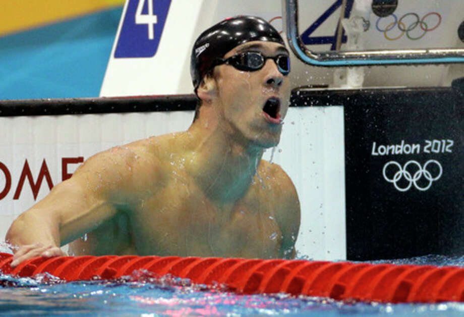 United States' Michael Phelps reacts to his gold medal win in the men's 100-meter butterfly swimming final at the Aquatics Centre in the Olympic Park during the 2012 Summer Olympics in London, Friday, Aug. 3, 2012. (AP Photo/Michael Sohn) / AP
