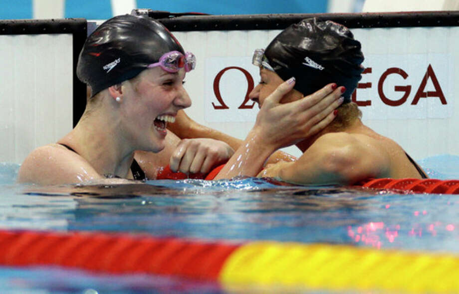 United States' Missy Franklin, left, and compatriot Elizabeth Beisel celebrate after their first and third place finishes in the women's 200-meter backstroke final at the Aquatics Centre in the Olympic Park during the 2012 Summer Olympics in London, Friday, Aug. 3, 2012. (AP Photo/Michael Sohn) / AP