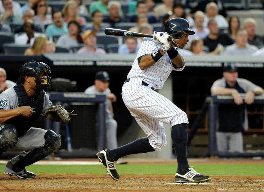 New York Yankees' Curtis Granderson follows through on a two-run single off of Seattle Mariners starting pitcher Kevin Millwood in the third inning of a baseball game Friday, Aug. 3, 2012, at Yankee Stadium in New York. (AP Photo/Kathy Kmonicek) / FR170189 AP