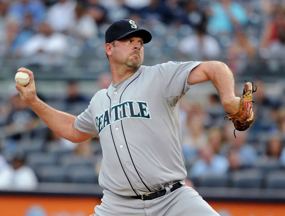 Seattle Mariners starting pitcher Kevin Millwood throws to a New York Yankees batter in the first inning of a baseball game Friday, Aug. 3, 2012, at Yankee Stadium in New York. (AP Photo/Kathy Kmonicek) / FR170189 AP