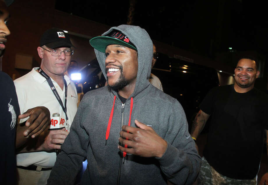Floyd Mayweather Jr., exits the Clark County Detention Center after serving two months of a three-month sentence in a misdemeanor domestic battery case, Friday, Aug. 3, 2012, in Las Vegas. (AP Photo/Isaac Brekken) / FR159466 AP