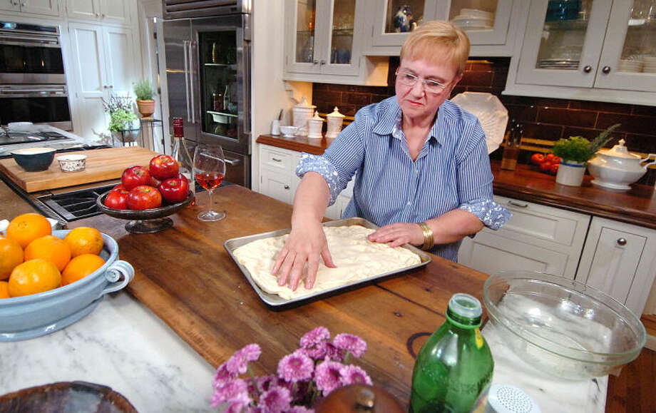Hour Photo/Alex von Kleydorff Lidia Bastianich pounds out some dough while taping episodes of her TV show at Clarke Kitchens showroom in South Norwalk on Tuesday.