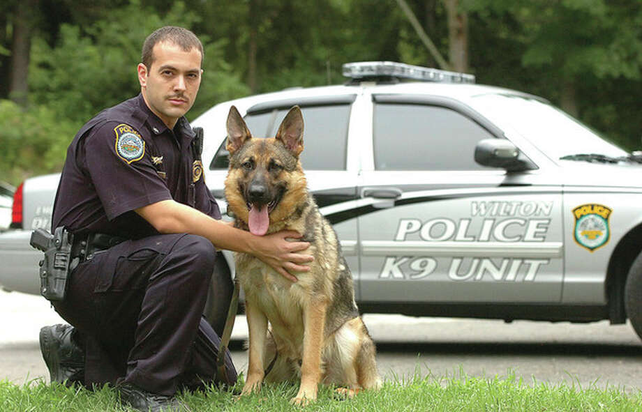 Hour photo / Alex von KleydorffWilton Police Officer Steven Rangel with the new K9 Enzo. / 2012 The Hour Newspapers