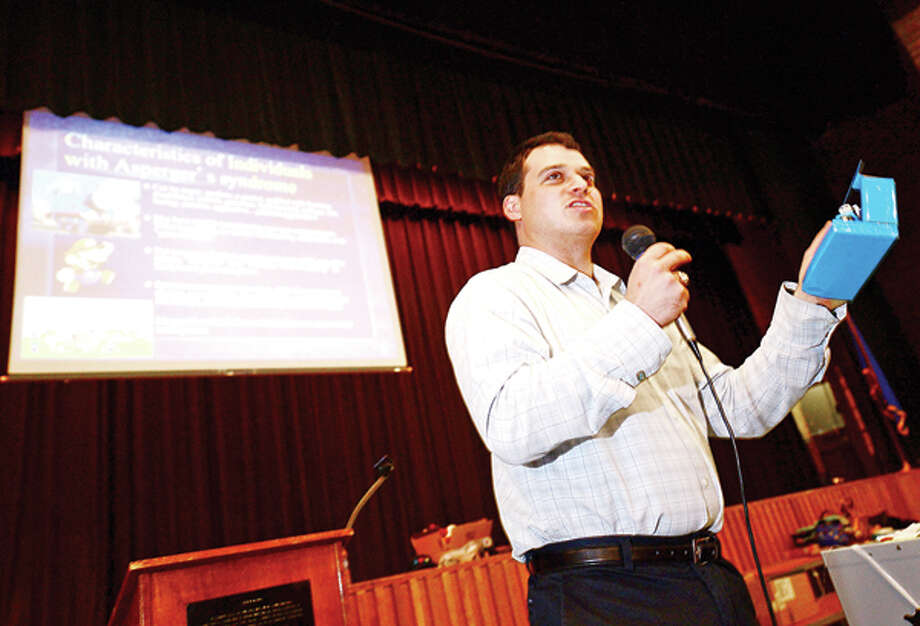 Author Jesse Saperstein talks to students about his book, Atypical: Life with Aspergers at Cloonan Middle School in Stamford Thursday. Hour photo / Erik Trautmann / (C)2013, The Hour Newspapers, all rights reserved