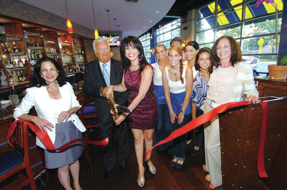 Hour Photo/ Alex von KleydorffNitzy Cohen cuts the ribbon to open her new restauarnt in South Norwalk, Atlas. / 2012 The Hour Newspapers