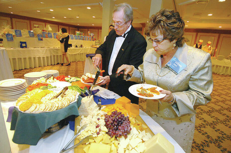 Hour photos / Alex von KleydorffSteve and Vicky Sabol sample some appetizers. / 2013 The Hour Newspapers