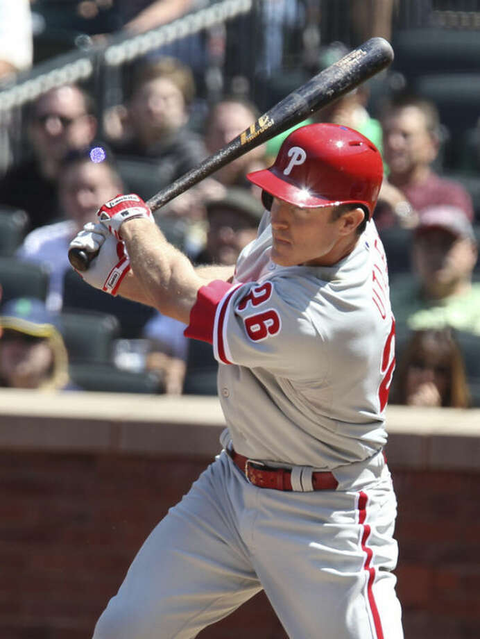 Philadelphia Phillies Chase Utley hits a run-scoring, ground rule double during the third inning of a baseball game against the New York Mets in New York on Saturday, April 27, 2013. (AP Photo/Peter Morgan)