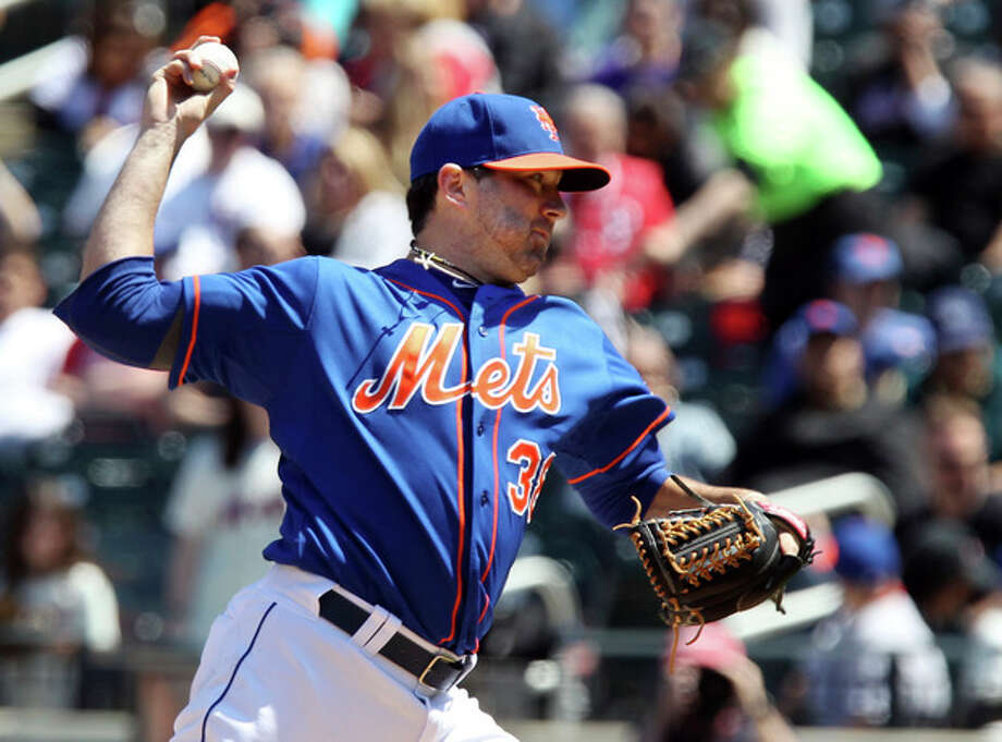New York Mets starting pitcher Shaun Marcum throws against the Philadelphia Phillies in the first inning of a baseball game in New York on Saturday, April 27, 2013. (AP Photo/Peter Morgan) / AP