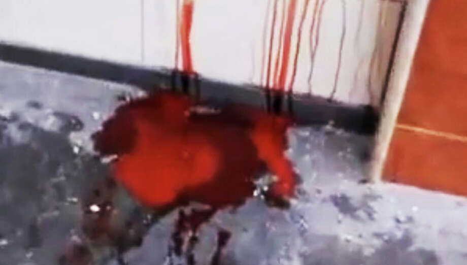 This image made from amateur video and released by Shaam News Network Tuesday, Dec. 27, 2011, purports to show the blood of men killed from shells in Homs, Syria, Monday, Dec. 26, 2011. (AP Photo/Shaam News Network via APTN) THE ASSOCIATED PRESS CANNOT INDEPENDENTLY VERIFY THE CONTENT, DATE, LOCATION OR AUTHENTICITY OF THIS MATERIAL. TV OUT / Shaam News Network