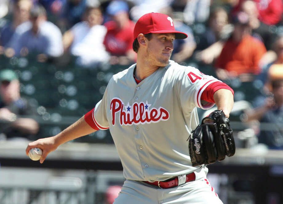Philadelphia Phillies starting pitcher Jonathan Pettibone throws against the New York Mets in the first inning of a baseball game in New York on Saturday, April 27, 2013. (AP Photo/Peter Morgan) / AP