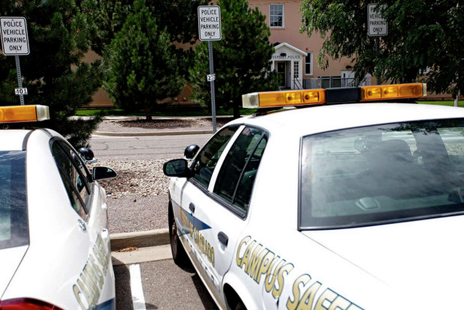 University of Colorado Police patrol car are parked in front of the police headquarters at the University of Colorado Medical Campus in Aurora, Colo.,on Thursday, August 2, 2012. Suspected movie theater shooter James Holmes was studying neuroscience at the medical school and a psychiatrist there raised an alarm about his behavior. In the wake of a student's deadly attack at Virginia Tech five years ago, schools across the country put into place teams meant to bring together faculty and staff to notice _ and take action _ when a student appears to be a threat. The school won't say if campus police ever were alerted to Holmes, or whether faculty or staff ivestigated his behavior.(AP Photo/Ed Andrieski) / AP