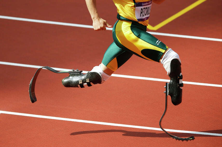 South Africa's Oscar Pistorius competes in a men's 400-meter heat during the athletics in the Olympic Stadium at the 2012 Summer Olympics, London, Saturday, Aug. 4, 2012. (AP Photo/Daniel Ochoa De Olza) / AP