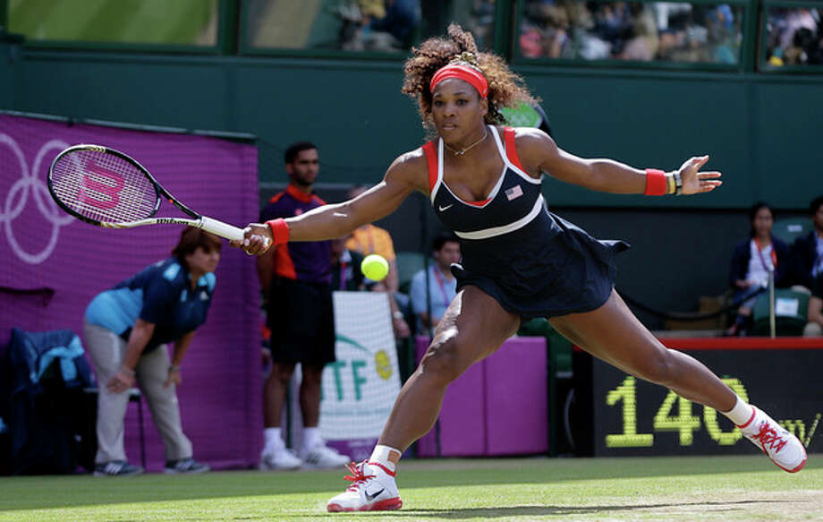 United States' Serena Williams returns a shot to Maria Sharapova of Russia in the women's singles gold medal match at the All England Lawn Tennis Club at Wimbledon, in London, at the 2012 Summer Olympics, Saturday, Aug. 4, 2012. (AP Photo/Elise Amendola) / AP