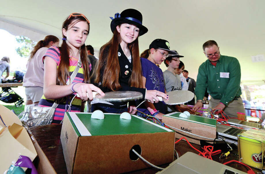 Abby Connolly and Olivia LIebler try their hand at Makey Makey Ping Pong during the Westport Mini Maker Fair at Jesup Geen Saturday, a showcase of invention, creativity and resourcefulness, where people from tech enthusiasts to crafters to homesteaders to scientists to garage tinkerers show what they are making, and share what they are learning.Hour photo / Erik Trautmann / (C)2013, The Hour Newspapers, all rights reserved