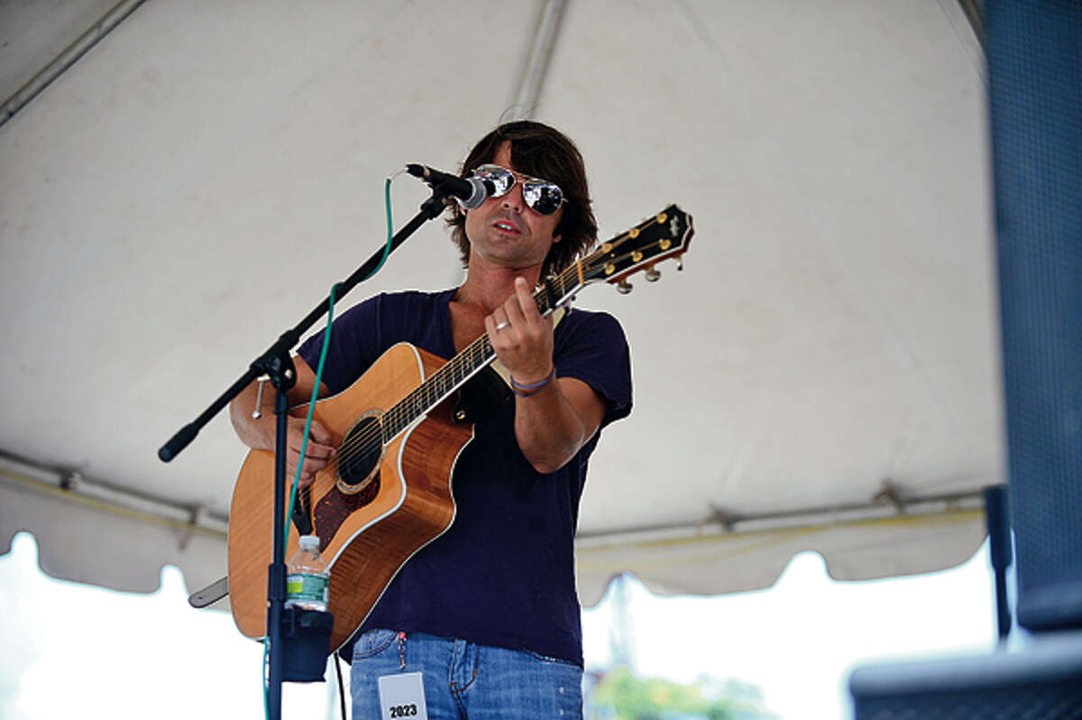 PJ Pacifico plays during The 37th Annual SoNo Arts celebration Saturday. Hour photo / Erik Trautmann