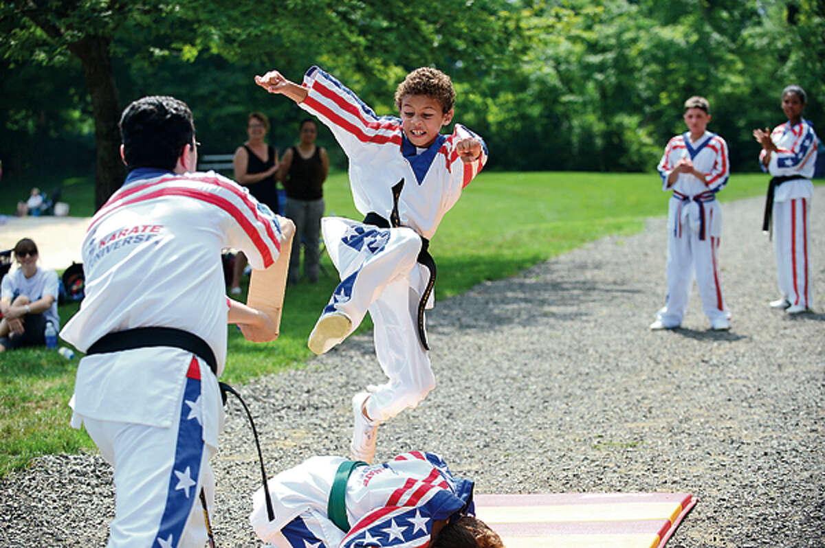 Jeremy Cooke participates in the Kicks for Kids is a fundraiser by Karate Universe to help fight diabetes Saturday at Merwin Meadows in Wilton. Hour photo / Erik Trautmann