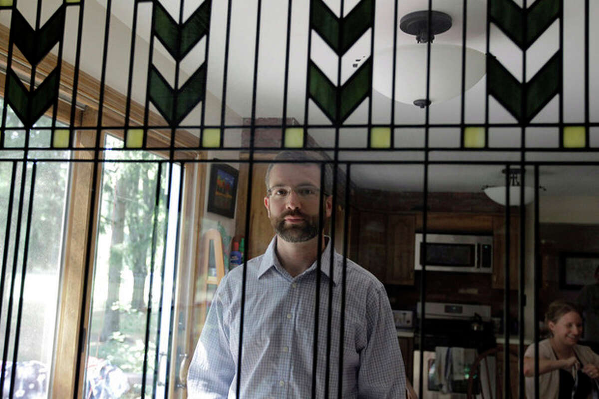 AP photo In this photo, Brian Castner poses for a photo at his home in Grand Island, N.Y. Castner, an Iraq war veteran, has written a book titled
