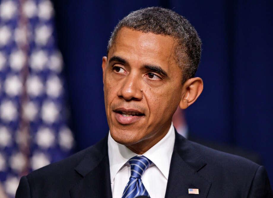 President Barack Obama talks abut taxes, Friday, August 3, 2012, in Eisenhower Executive Office Building on the White House campus in Washington. (AP Photo/J. Scott Applewhite) / AP