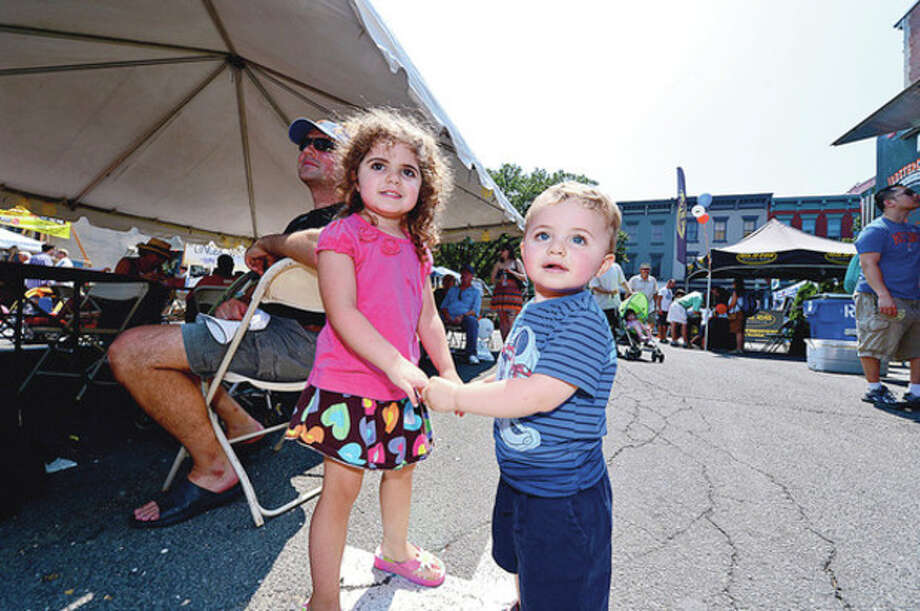 Clara and Colin Spraques dance to the sounds of The Hornitz during The 37th Annual SoNo Arts celebration Saturday.Hour photo / Erik Trautmann / (C)2012, The Hour Newspapers, all rights reserved