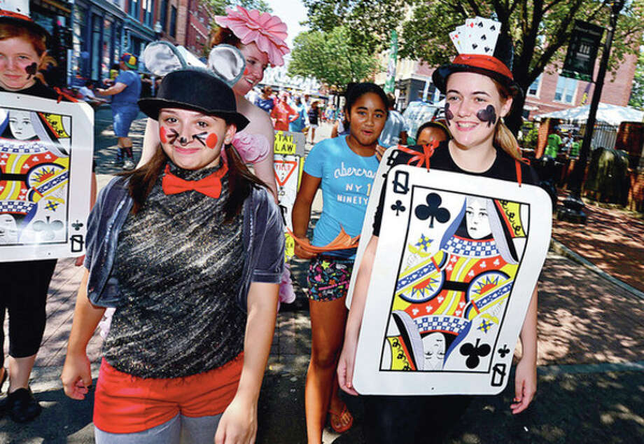 Crytsal Theater perfomers Jen Faccenda and Samantha Kulish parade down washington St during the The 37th Annual SoNo Arts celebration Saturday.Hour photo / Erik Trautmann / (C)2012, The Hour Newspapers, all rights reserved